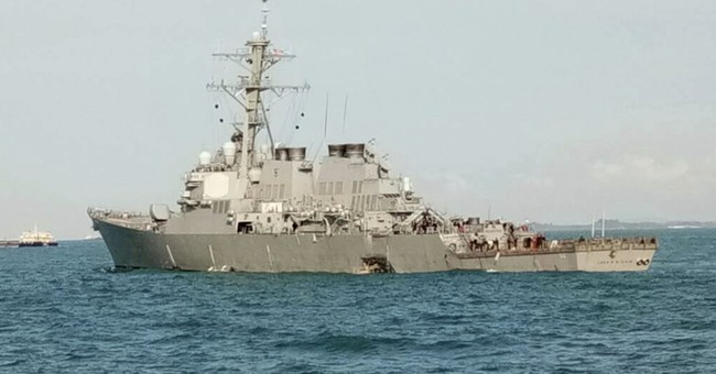 The Latest: Divers assessing damage on USS John S. McCain