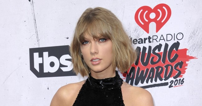 A reptilian tail? A solar eclipse. Taylor Swift teases fans