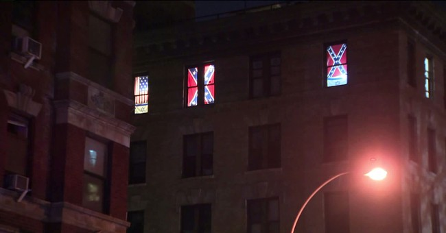 The Latest: Owner defends his NYC Confederate flag display