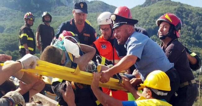 Italian boy credited with helping save brother after quake