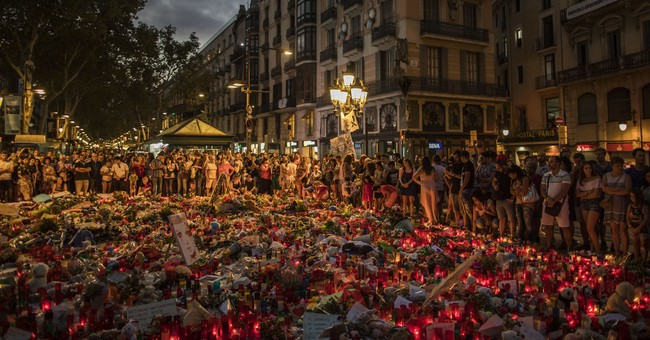 The Latest: Spain suspects bought weapons after first attack