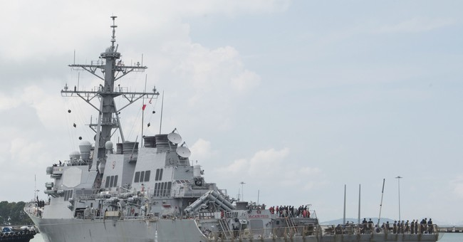US says some remains of sailors found on USS John McCain