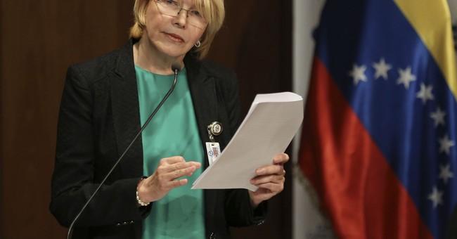 The Latest: Ousted Venezuela prosecutor vows graft evidence