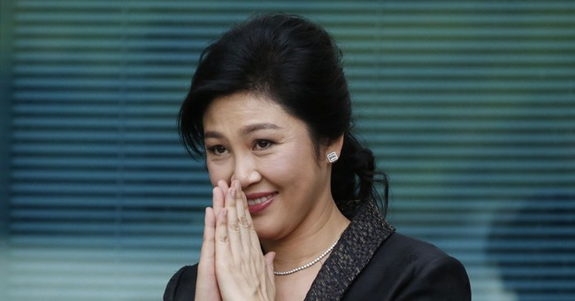 The Latest: Thai court to issue arrest warrant for former PM