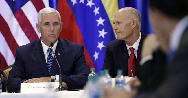 The Latest: Pence threatens more sanctions against Venezuela