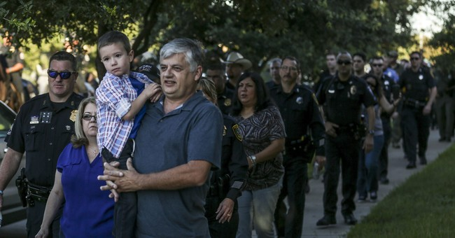 Slain Houston officer's son, 5, gets police escort to school
