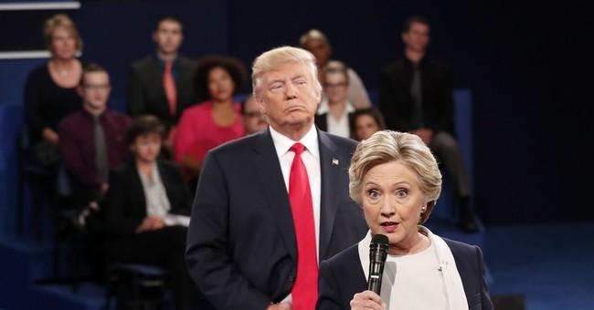 Clinton: My 'skin crawled' as Trump hovered on debate stage