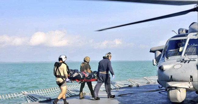 The Latest: Sea search suspended for sailors from USS McCain