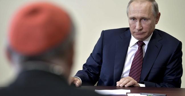 Putin hails dialogue between Vatican, Russia Orthodox Church