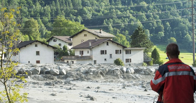 Swiss police: 8 missing after mudslide near Italian border