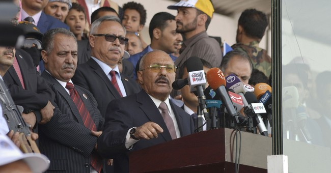 Yemenis backing ex-leader rally amid strains in rebel camp