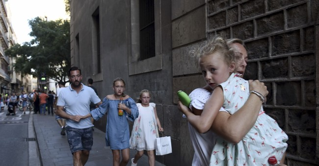 AP PHOTOS: The Barcelona attacks, the grief that followed