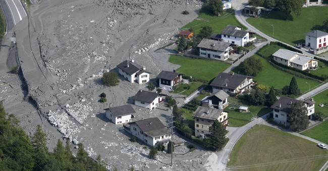 Search suspended for 8 missing in Switzerland landslide