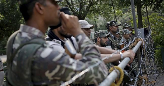 The Latest: 5 dead as Guru's backers riot after rape verdict