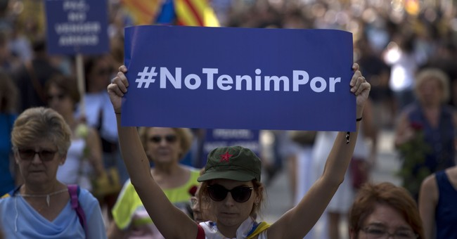 The Latest: Police say 500,000 attend Barcelona peace march