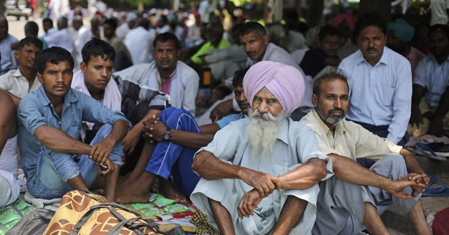 Despite crime allegations, gurus in India hold sway