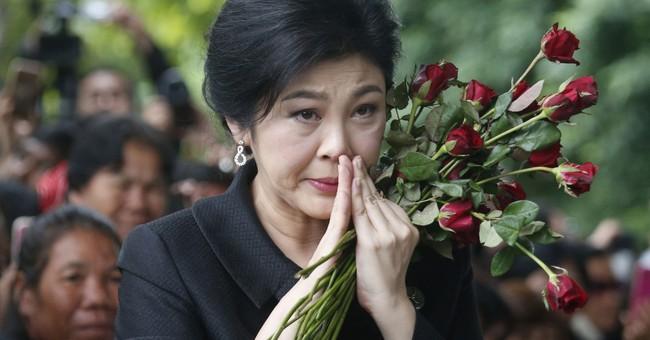 Analysis: Flight of ex-Thai prime minister boosts junta rule