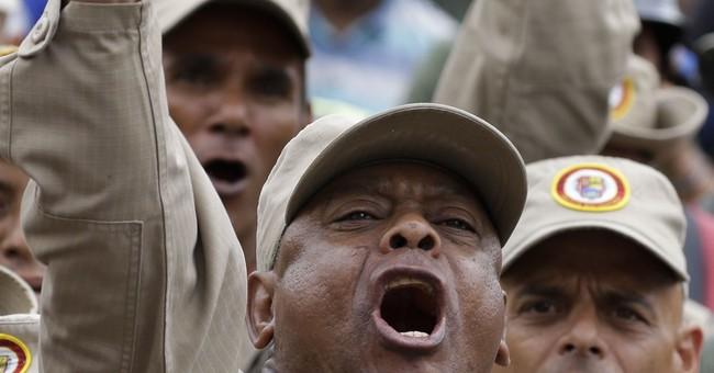 Venezuela shuts 2 radio stations, holds military exercises