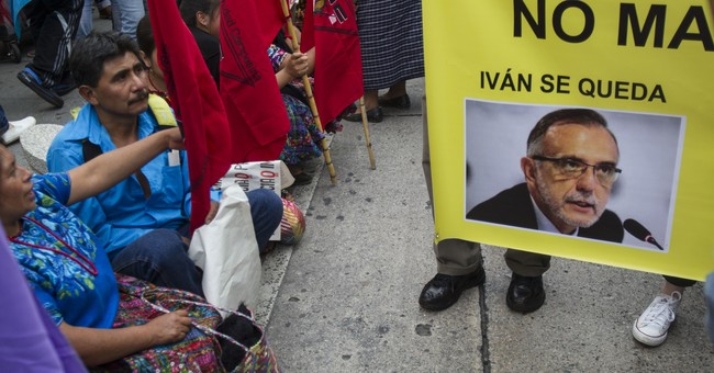 Guatemala president softens stand on expelling graft prober