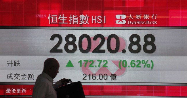 Asian shares mixed, US storm sends gasoline futures spiking