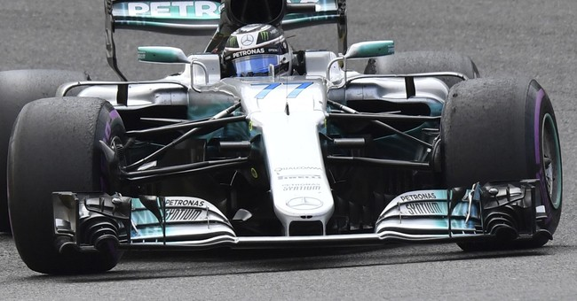 Hamilton holds off Vettel's late move to win Belgian GP