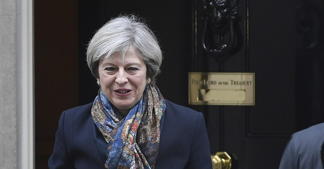 The Latest: May to reveal UK plans on Brexit in formal paper