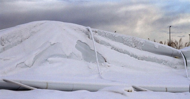 Snow-covered buildings collapsing in rare US West weather