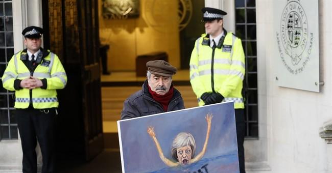 The Latest: UK to introduce Brexit legislation 'within days'