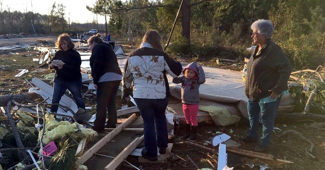 'Get up. We've got to get out': Storms kill 20 in the South