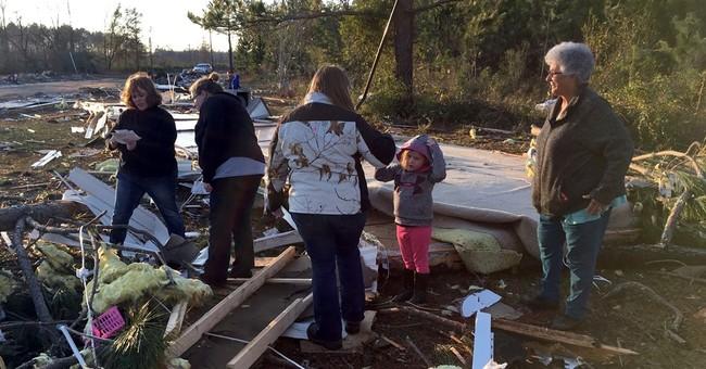 The Latest: Insurance commissioner estimates $100M in damage