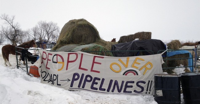 Last pipeline protesters weigh whether to fight or leave