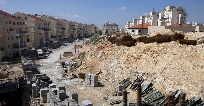 The Latest: Settler leader welcomes new West Bank homes