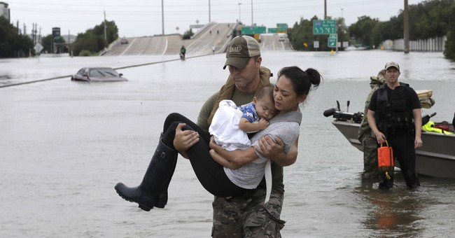 Photo of Harvey rescue spreads on internet, front pages