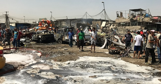 Iraq: Car bombing at busy Baghdad market kills 12 people