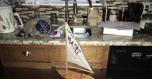 We planned to ride out Harvey, until the floodwaters came