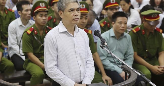 Vietnam tries dozens of bankers for graft, mismanagement