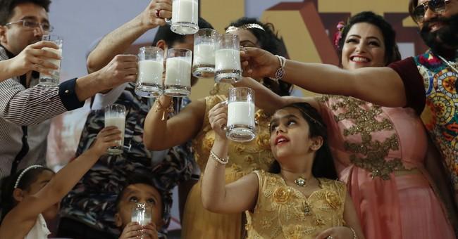 AP Photos: Flamboyant Indian guru sentenced to prison