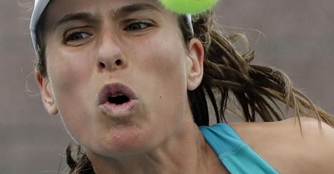 Emotional Sharapova tops No. 2 Halep at Open in Slam return