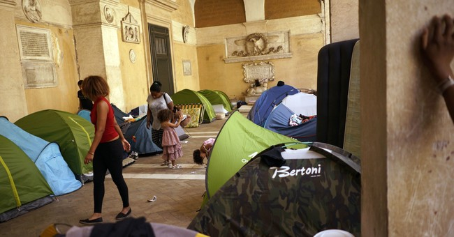 Rome eyes buildings confiscated from mafia to house migrants