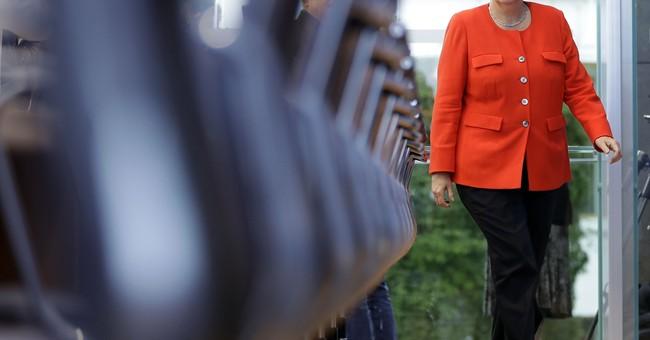 The Latest: Merkel open to idea of new eurozone minister