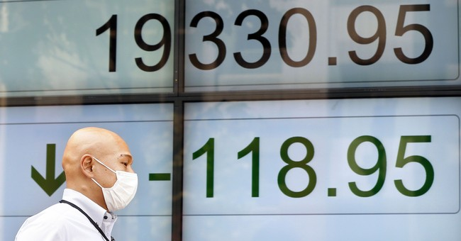 Global stocks in retreat after North Korean missile test