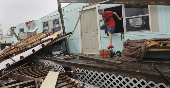 AP PHOTOS: Emergency crews overwhelmed by rescue calls