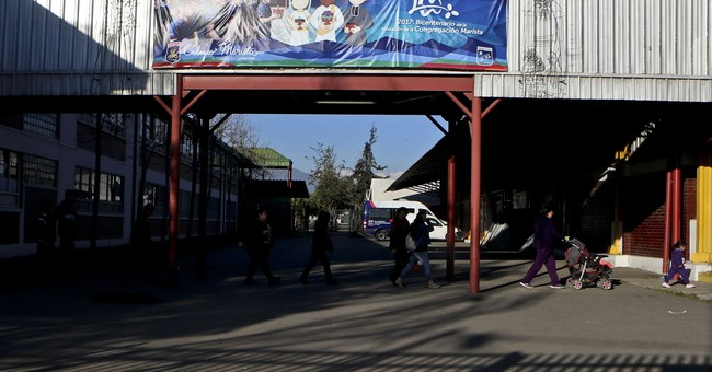 Marist Brothers say member abused 14 minors at Chile schools