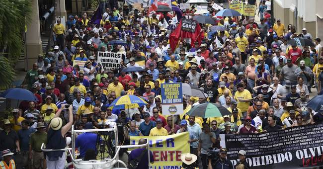 Hundreds of Puerto Ricans protest, decry austerity measures