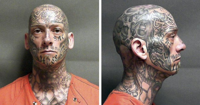 Authorities searching for heavily tattooed escaped inmate
