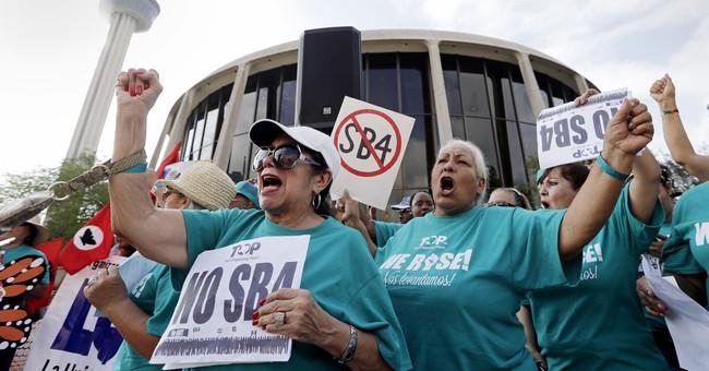 Federal judge blocks Texas' tough 'sanctuary cities' law