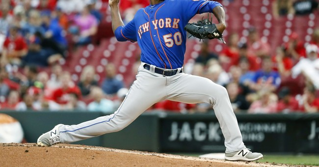 Montero takes 1-hitter into 9th, Mets beat Reds 2-0