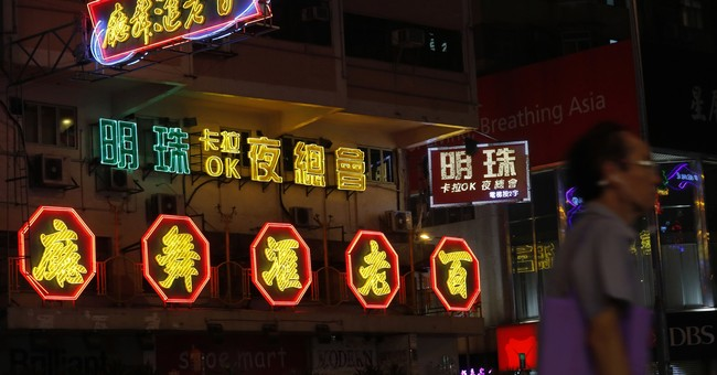 New rules, tech are dimming Hong Kong's signature neon glow