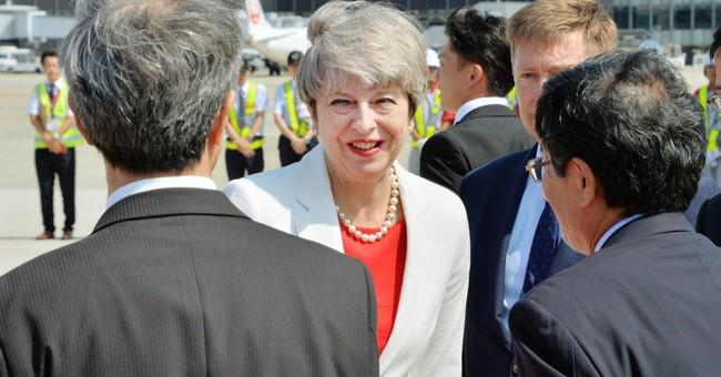 Britain's May says China should increase pressure on NKorea