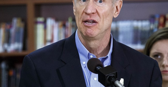 Illinois governor signs sweeping school funding changes